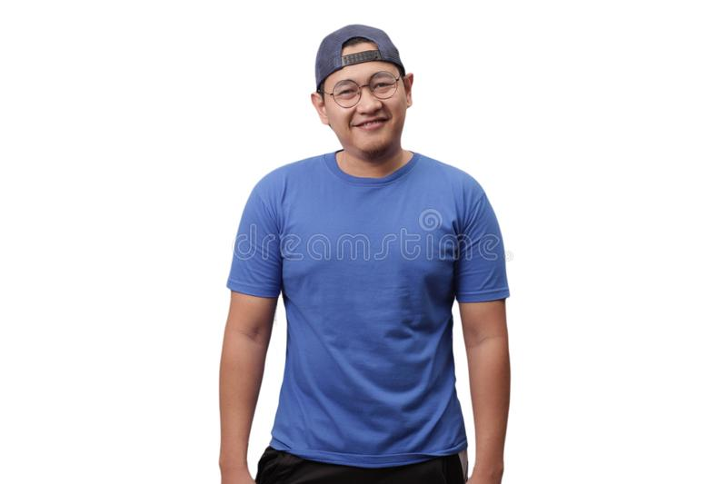 Young Asian Man Smiling, Happy Expression. Young Asian man wearing blue shirt smiling and laughing happily expression.  Isolated on white, human, one, single royalty free stock photo