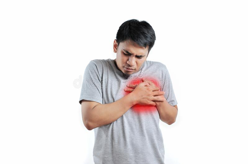 Young Asian man suffer from heart disease or heart attack stock photography