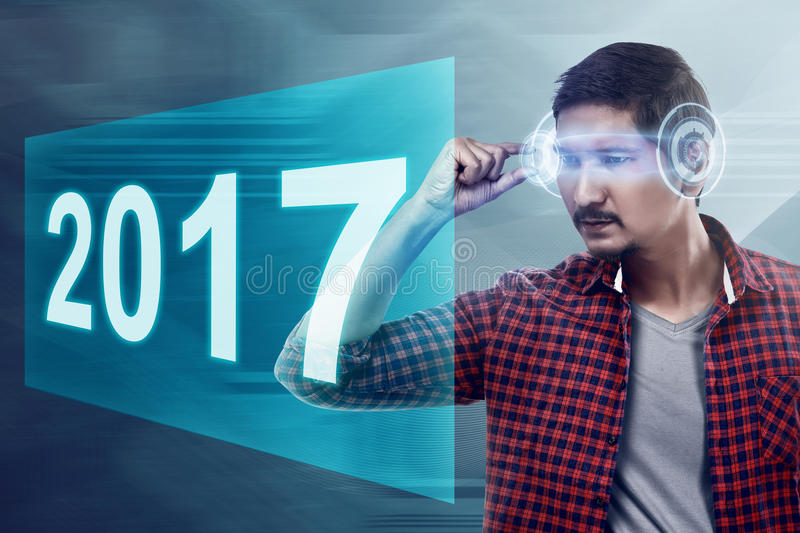 Young asian man wear VR headset looking into 2017 number stock illustration