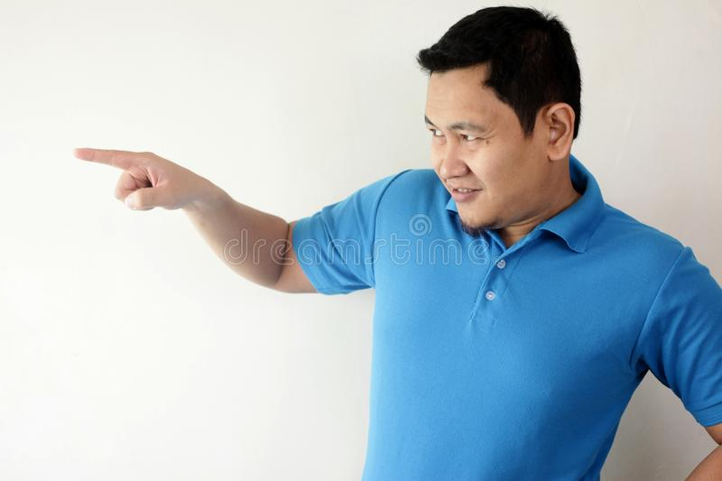 Young Man Pointing To The Side stock photos