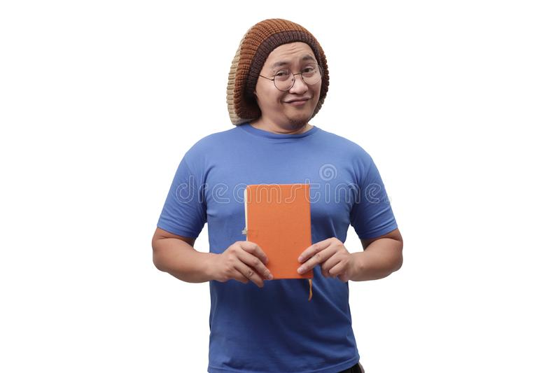 Young Man Holding a Book, Smiling Expression stock image