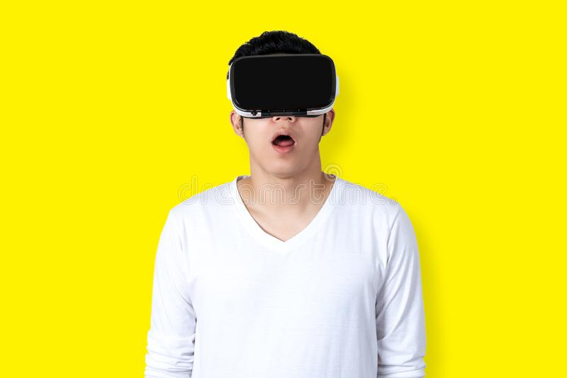 Young Asian Man Wearing Virtual Reality Glasses stock photography