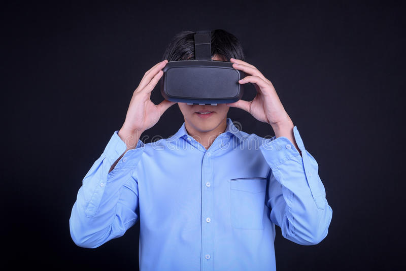 Young Asian man wearing virtual reality goggles royalty free stock photo