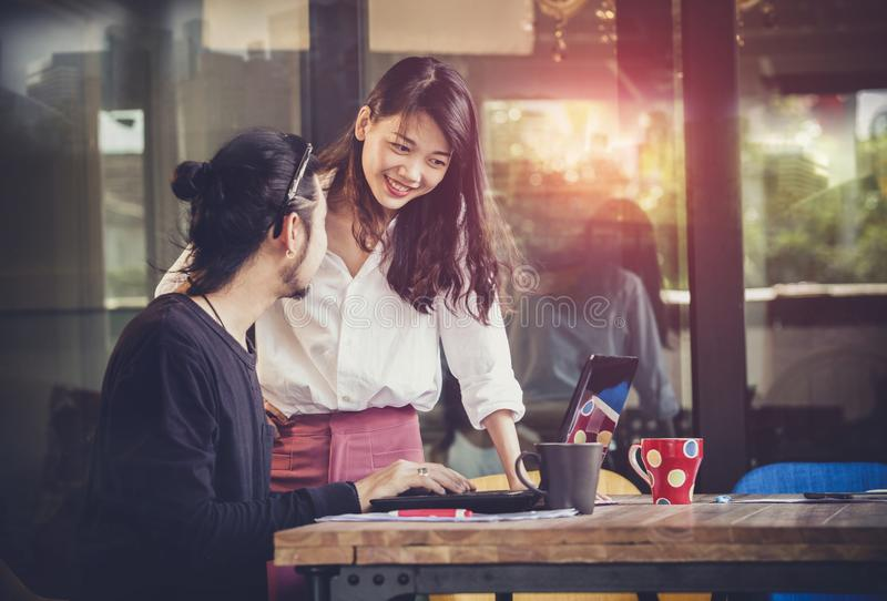 Young asian man and woman freelance working at home office royalty free stock photography