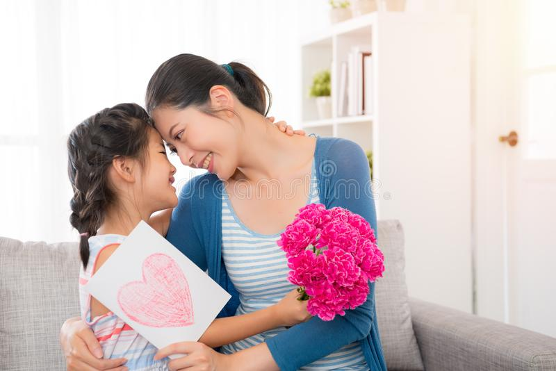 Young asian mother accept the little daughter card royalty free stock photo