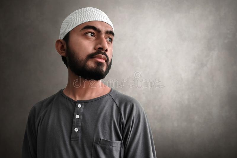 Young asian muslim man portrait stock photo