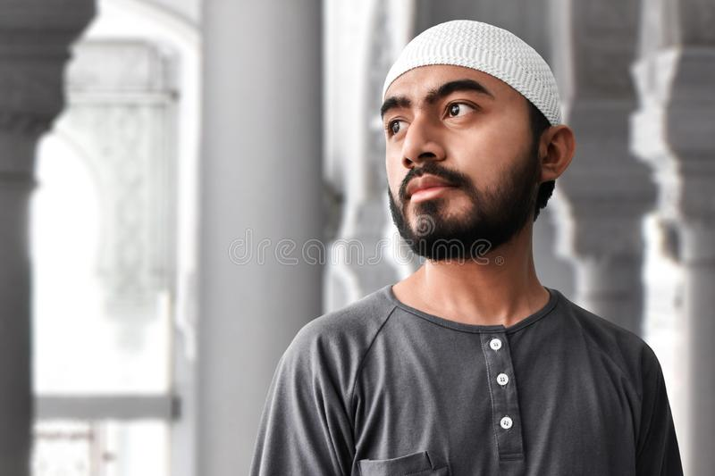 Young asian muslim man portrait stock photography