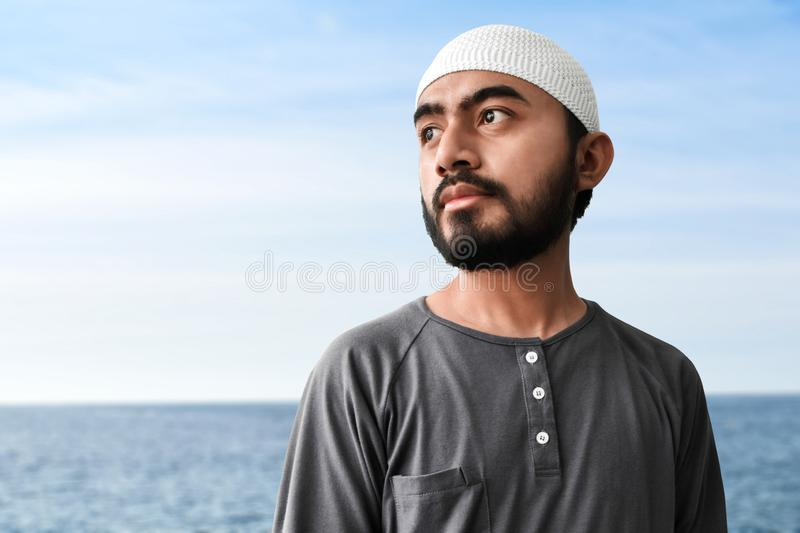 Young asian muslim man portrait stock images
