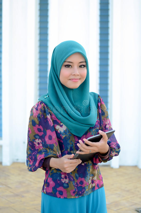 Young asian muslim woman in head scarf smile together royalty free stock images