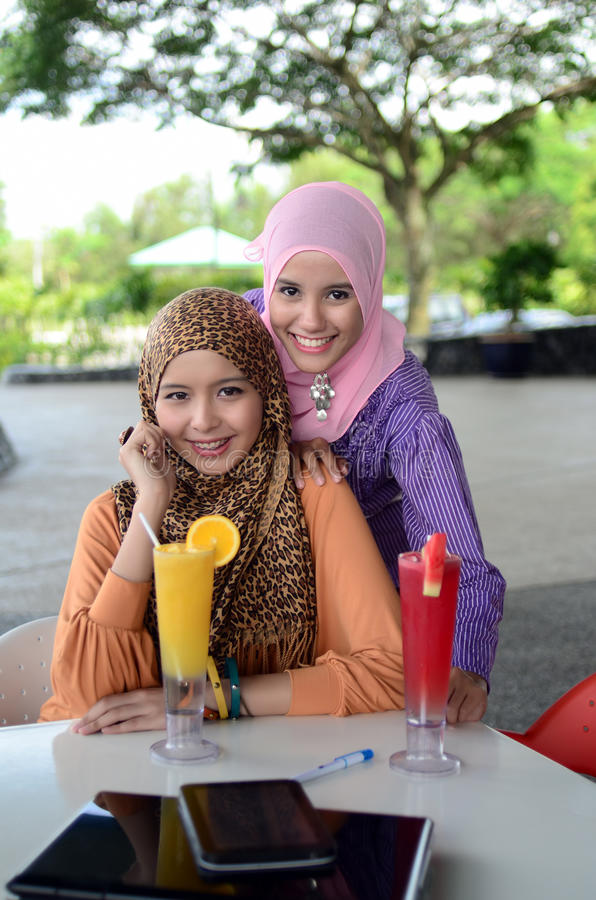 Young asian muslim woman in head scarf stock photography