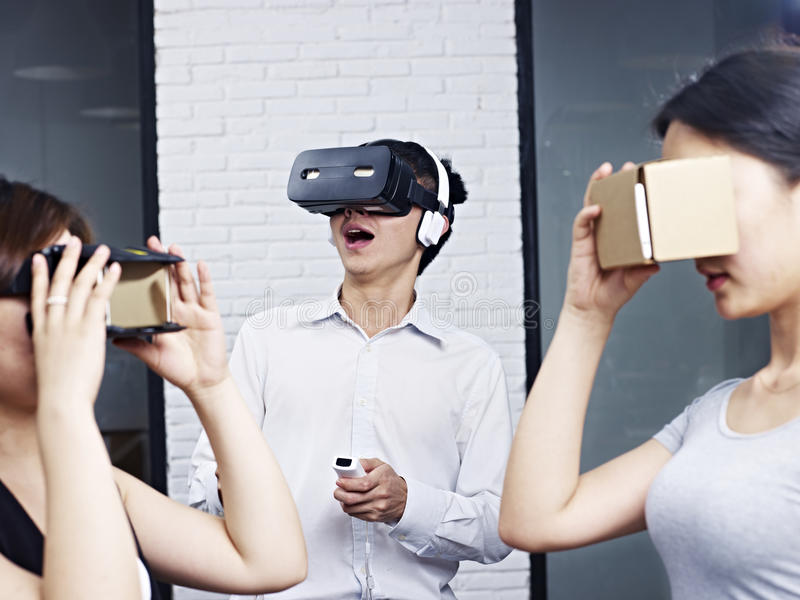 Young asian people trying virtual reality goggles stock photos