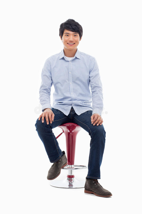 Young Asian Person Sitting On The Chair. Stock Image ...