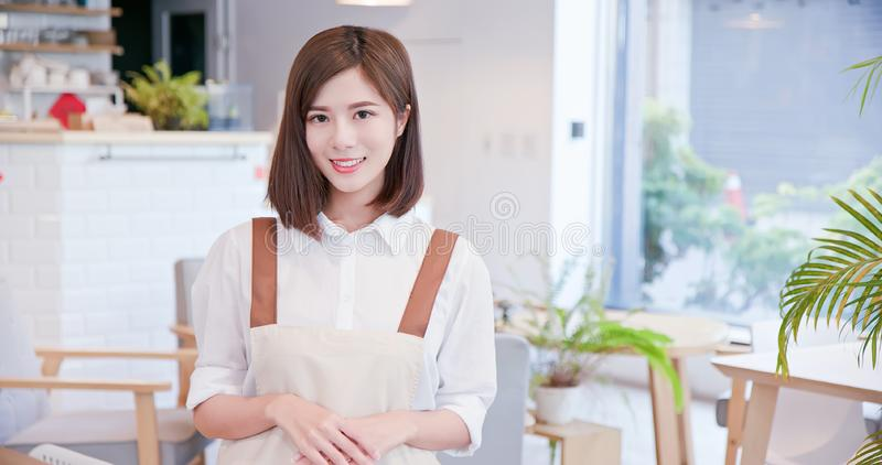 Young asian shopkeeper smile stock photography