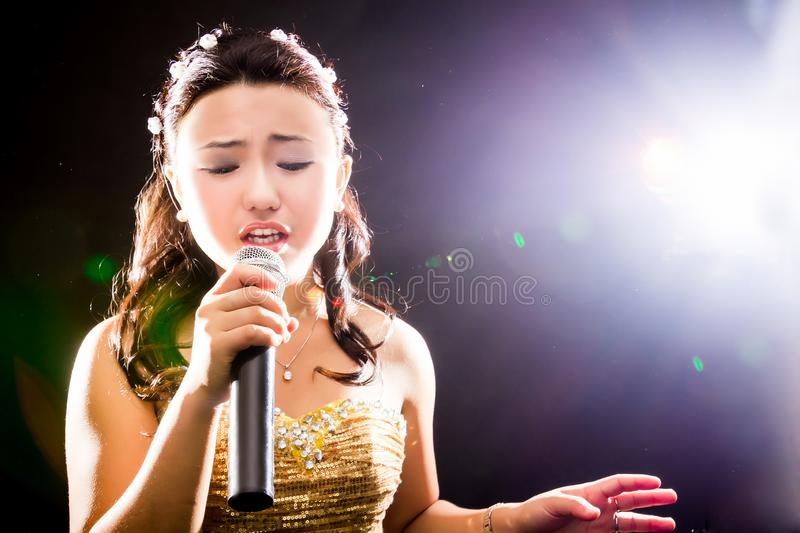 Singing woman of Asia stock photos