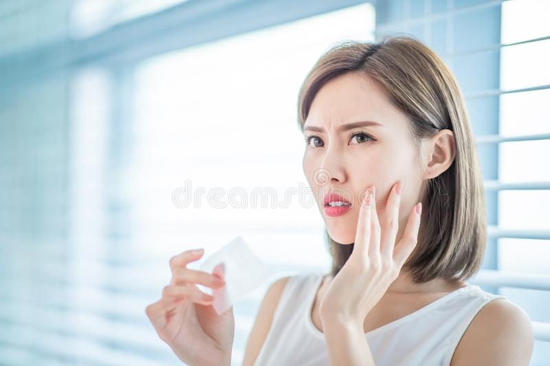 Woman use oil blotting paper royalty free stock photo