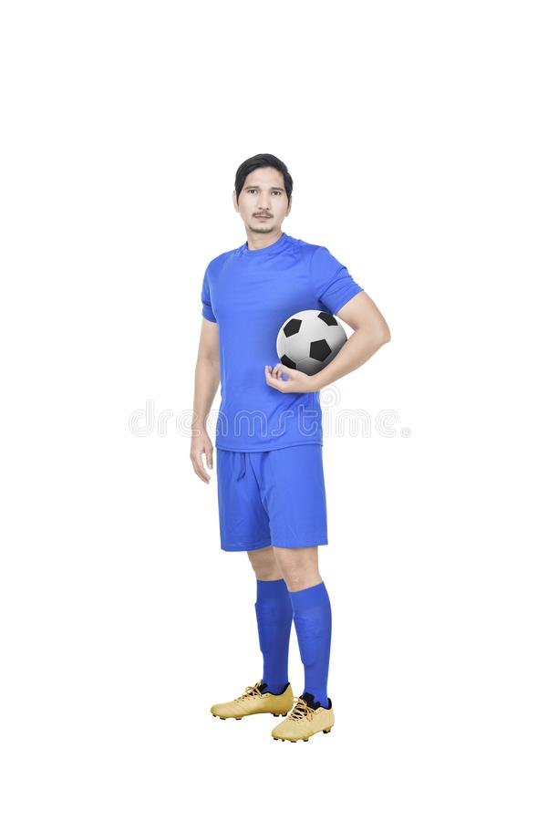 Young asian soccer player standing royalty free stock image