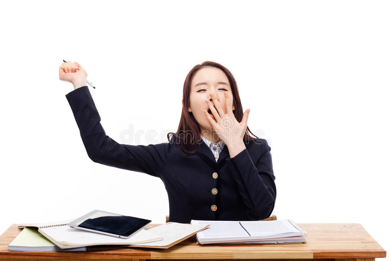 Young Asian student stretch oneself with a yawn stock photo