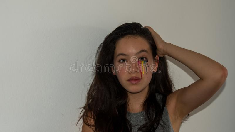 Young Asian teen with colorful tear drop make up royalty free stock image