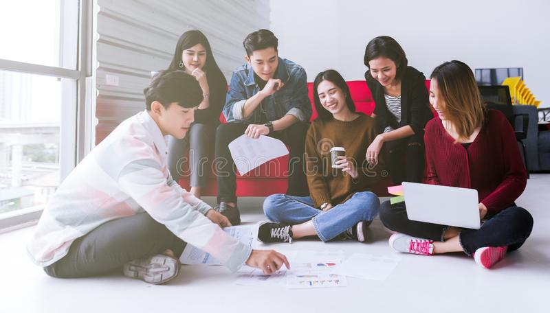Young asian teen group meeting discuss or brainstorm business strategy doing project in modern office. royalty free stock images