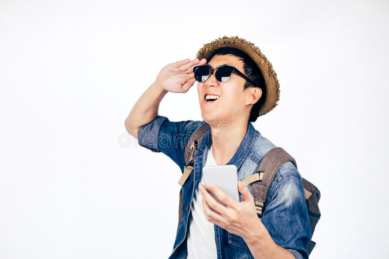 Young Asian tourist with hat smiling with smartphone isolated over white background. royalty free stock photography