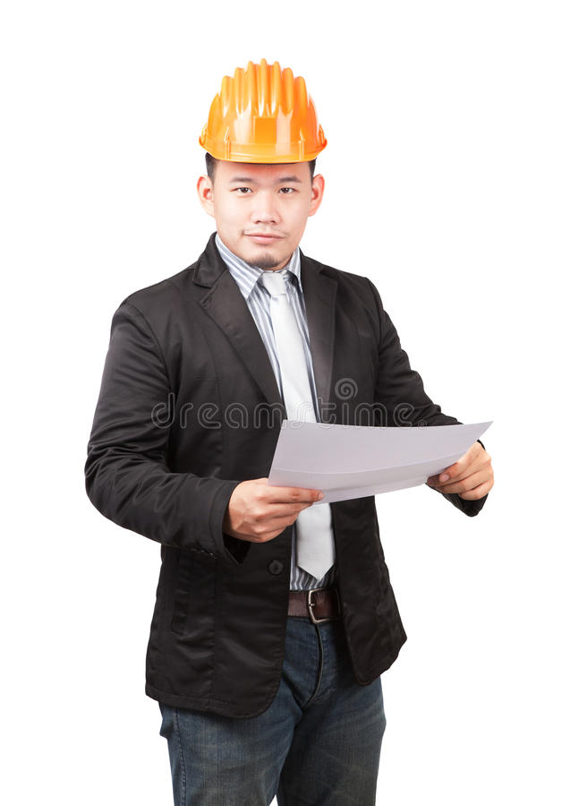 Young asian wearing safety helmet working engineering man holding project paper work isolated white background use for engineer w. Orking in construction site royalty free stock images