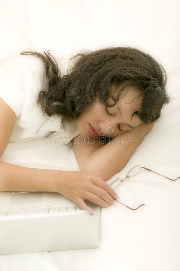 Young asian woman in bed stock photo