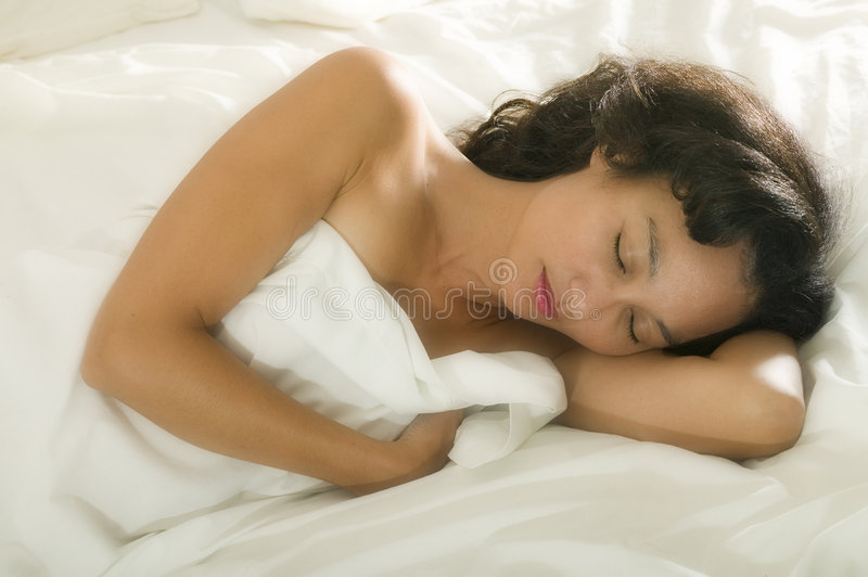 Young asian woman in bed royalty free stock image