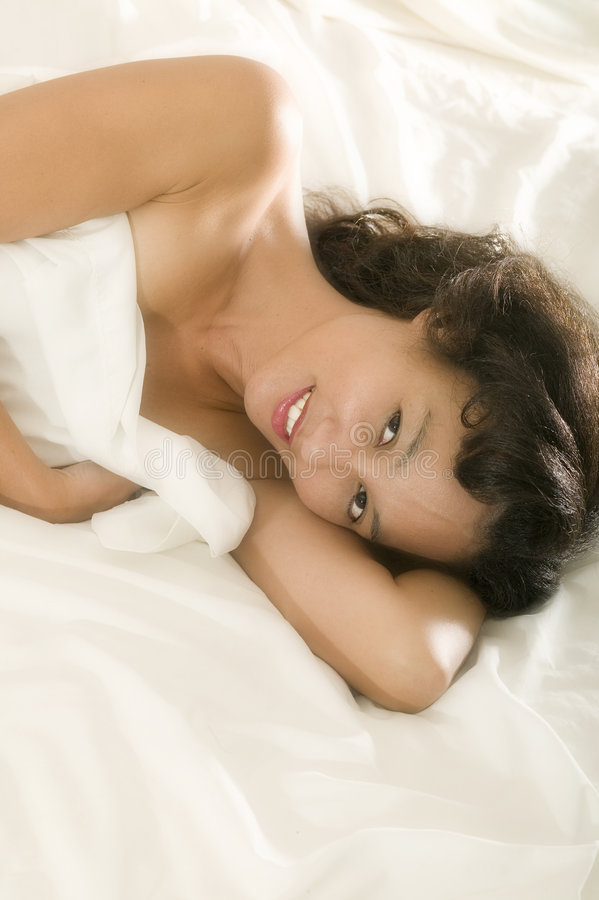 Young asian woman in bed stock images