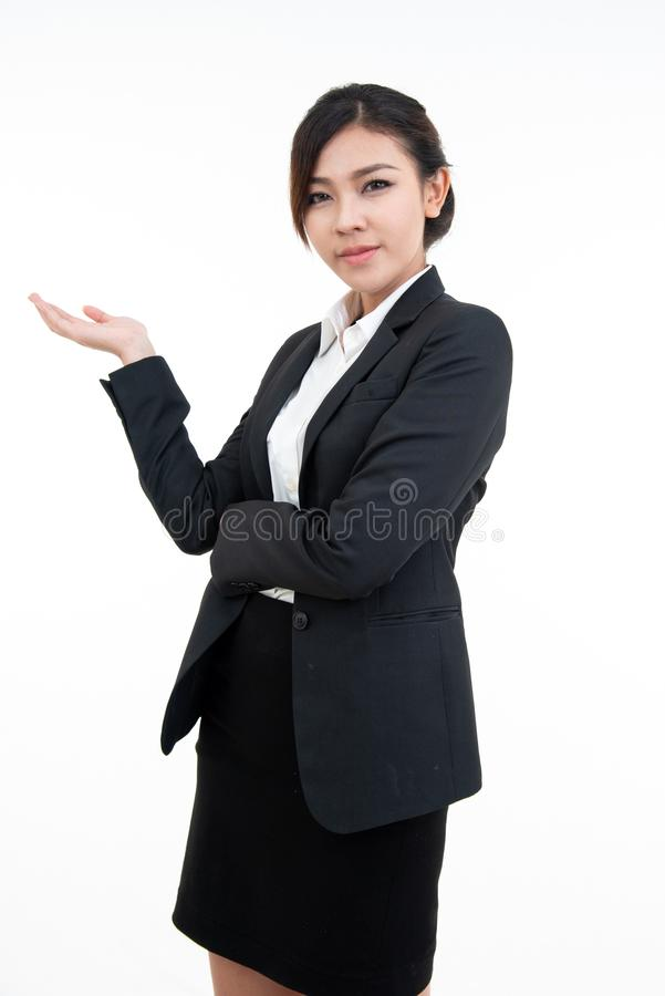 Young asian woman in black suit open her hand palm with smile and isolated on white background with clipping path stock images