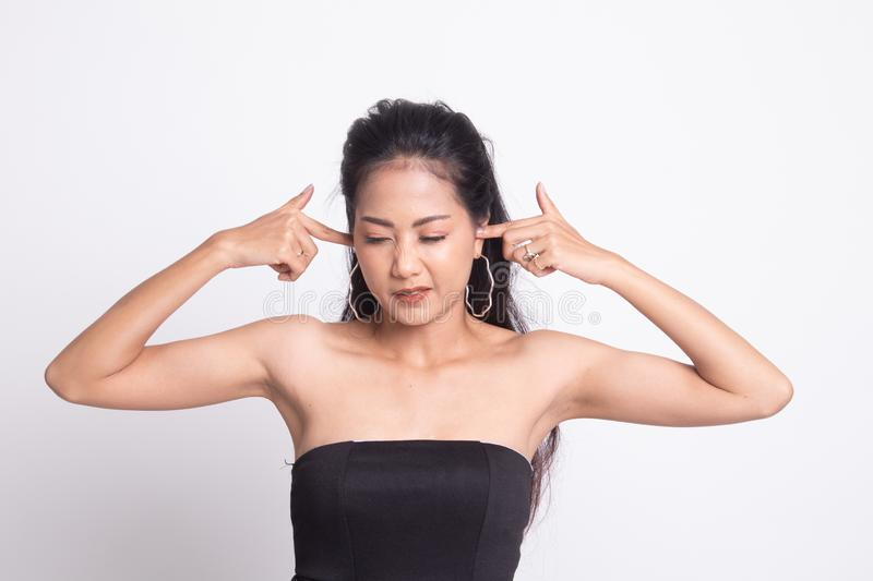 Young Asian woman block both ears with fingers. Young Asian woman block both ears with finger on white background stock image