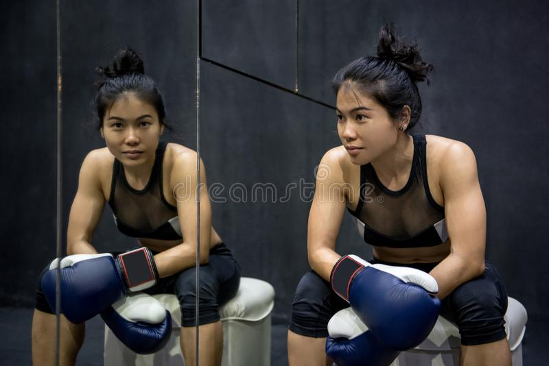 Young Asian woman posing with boxing gloves stock photos