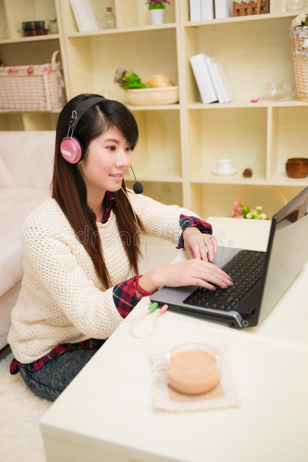 Free Young Asian Woman Chatting With Laptop Stock Image - 31177771