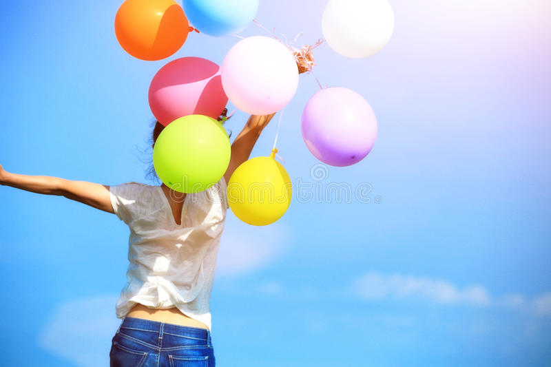 Young asian woman with colored balloons royalty free stock photo