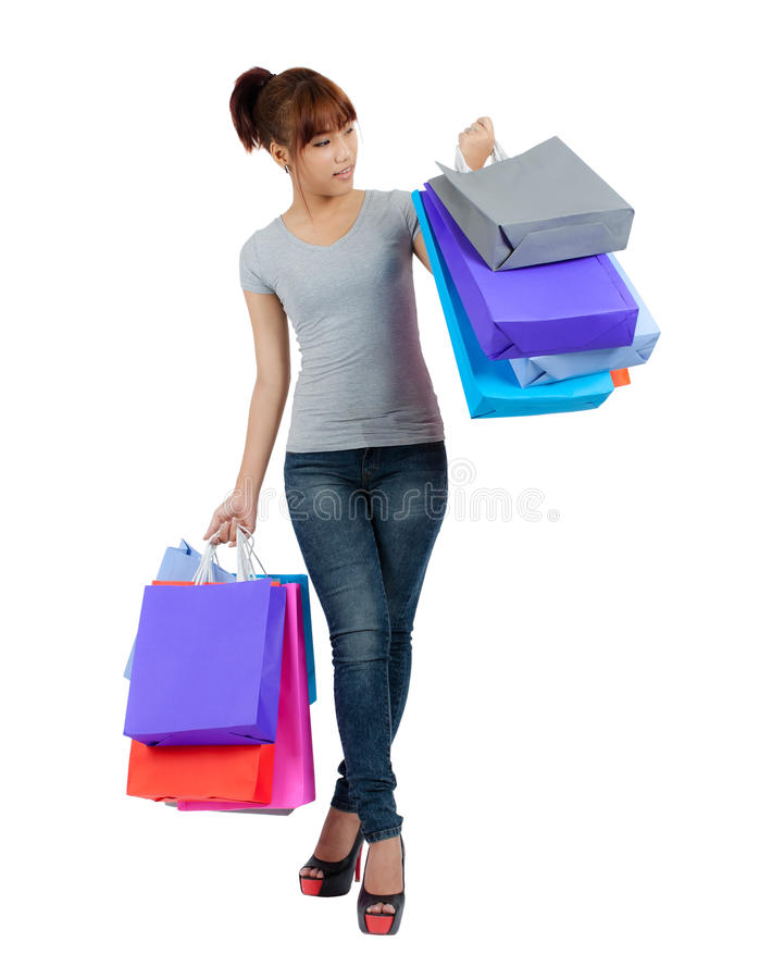 Young Asian Woman With colorful Shopping Bags. Isolated Young Asian Woman With colorful Shopping Bags stock images