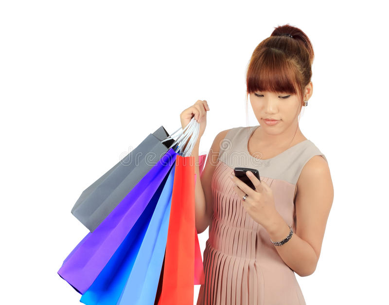 Young Asian Woman With colorful Shopping Bags. Isolated Young Asian Woman With colorful Shopping Bags royalty free stock photos