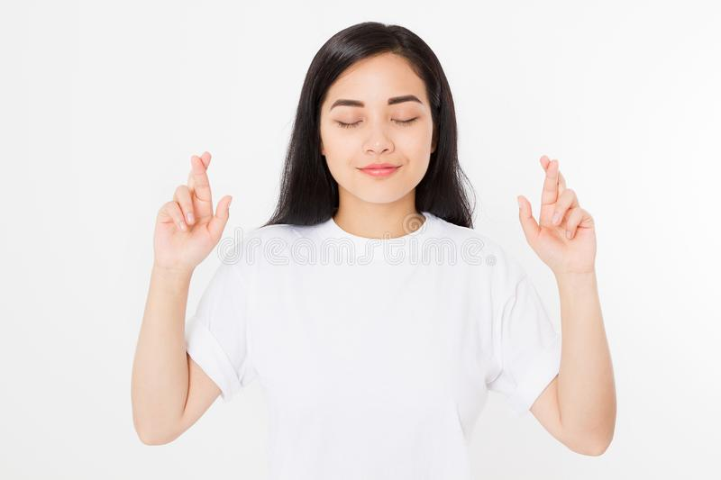 Young asian woman cross fingers for wishing good luck isolated on white background.Template summer t shirt. Copy space.  stock photography