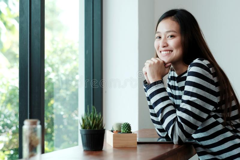 Young asian woman with digital tablet sitting in cafe background, people and technology lifestyle stock images