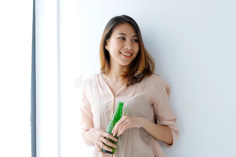 Young asian women drinking beer and smiling with happiness, lifestyle royalty free stock image