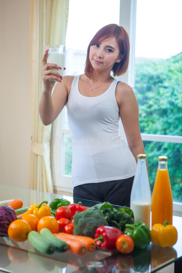 Young asian woman drinking milk stock photo