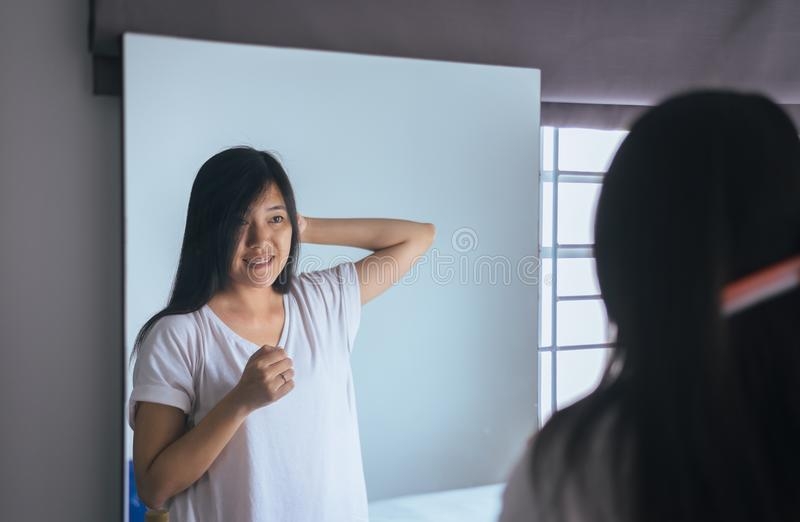 Young asian woman drying hair with towel,Female drying her long hair with comb royalty free stock photos