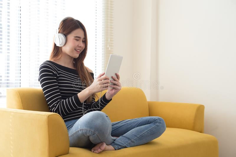 Young asian woman embrace smartphone on the bed stock photos
