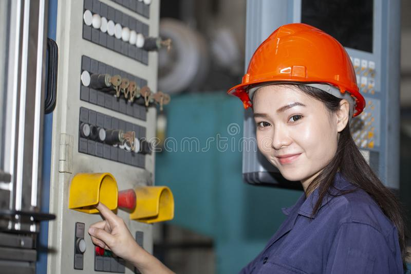 Young asian woman engineer set up and testing machine. In the laboratory factory, engineering and industrial concept stock image