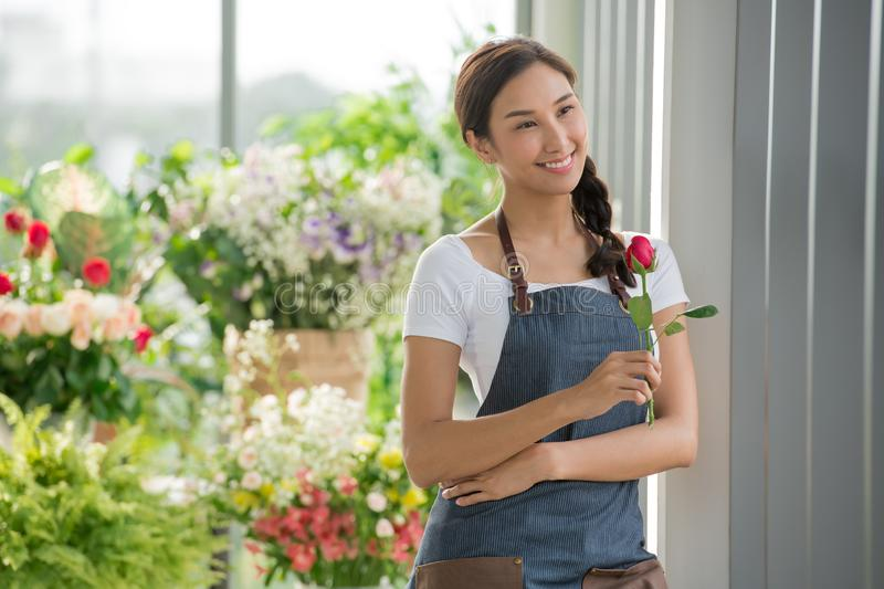 Young Asian woman entrepreneur/shop owner/ florist of a small flower shop business royalty free stock photos