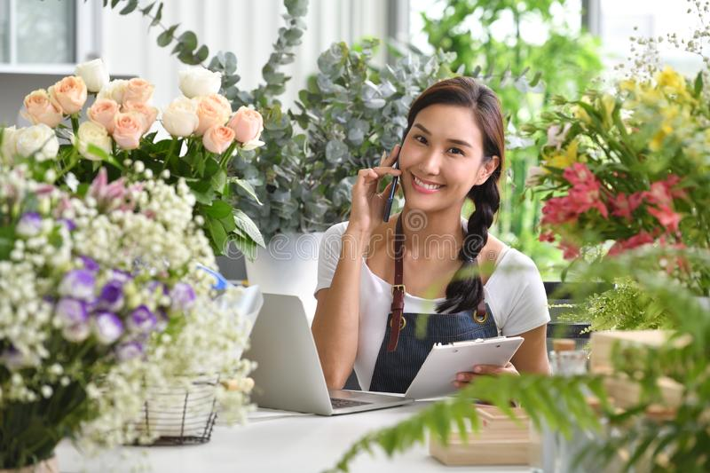 Young Asian woman entrepreneur/shop owner/ florist of a small flower shop business royalty free stock images