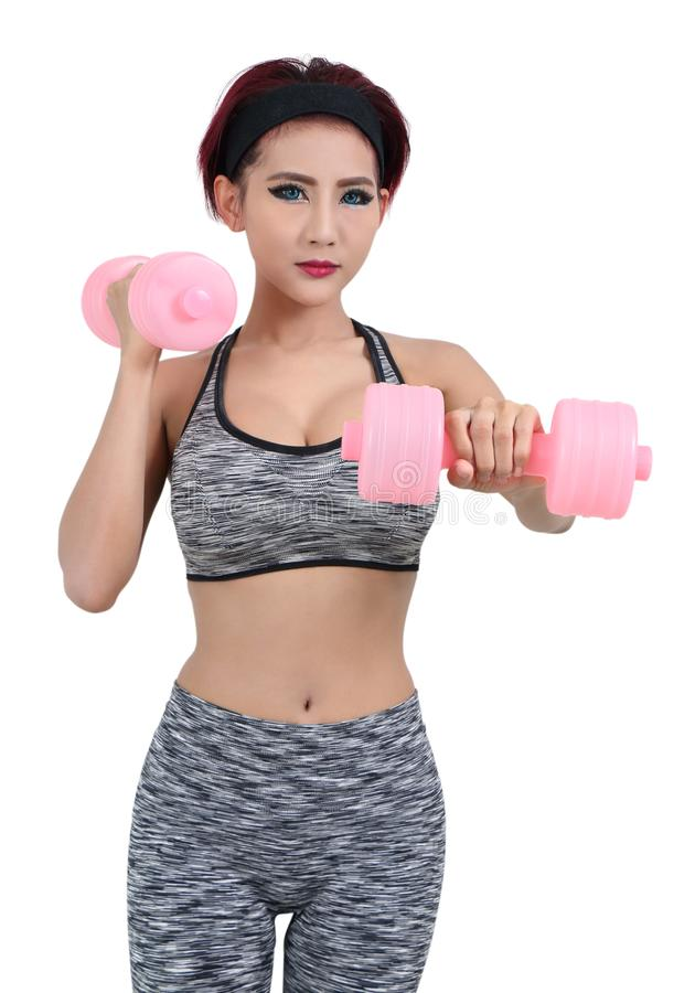 Woman in sport. Young asian woman in fitness clothes and holding dumbbell stock photography