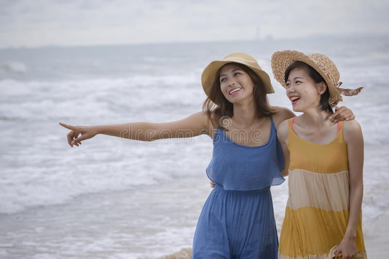Young asian woman friend relaxing emotion at sea beach summer va stock photography