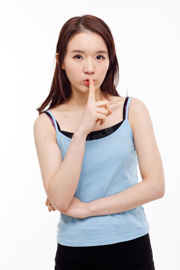 Young Asian woman gesture dont' make sound. stock photo