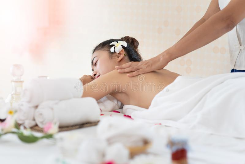 Young Asian woman getting massage in the spa salon, enjoying and relaxing royalty free stock photos