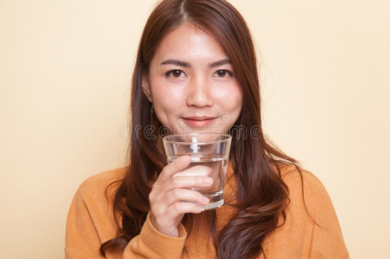 Young Asian woman with a glass of drinking water. royalty free stock photo