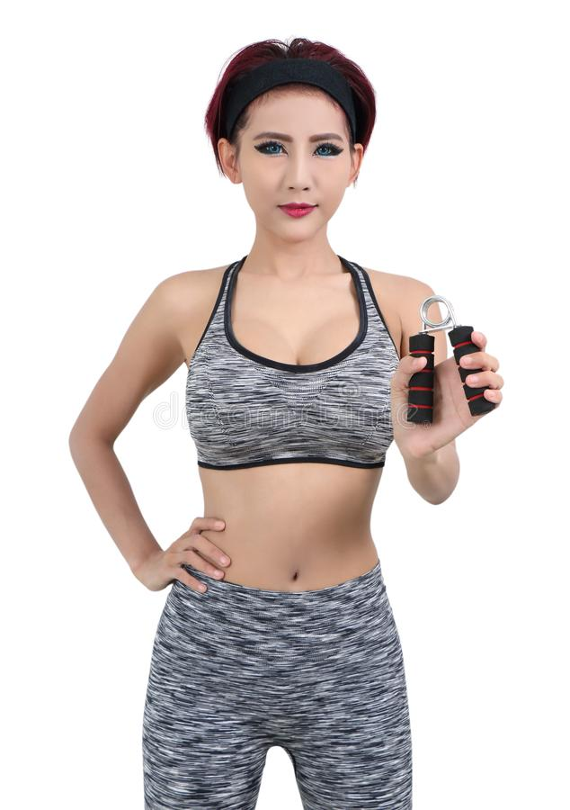 Woman in sport. Young asian woman in gray fitness clothes royalty free stock photo